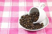Xícara de café e grãos de café — Foto Stock