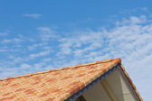 Roof of the house and the autumn sky — Stock Photo