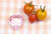 Cherry tomatoes and pink heart — Stock Photo