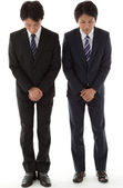 Two young businessmen with a bow — Stock Photo