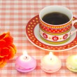 Artificial rose and candles and coffee — Stock Photo