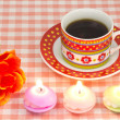 Artificial rose and candles and coffee — Stock Photo #19170137
