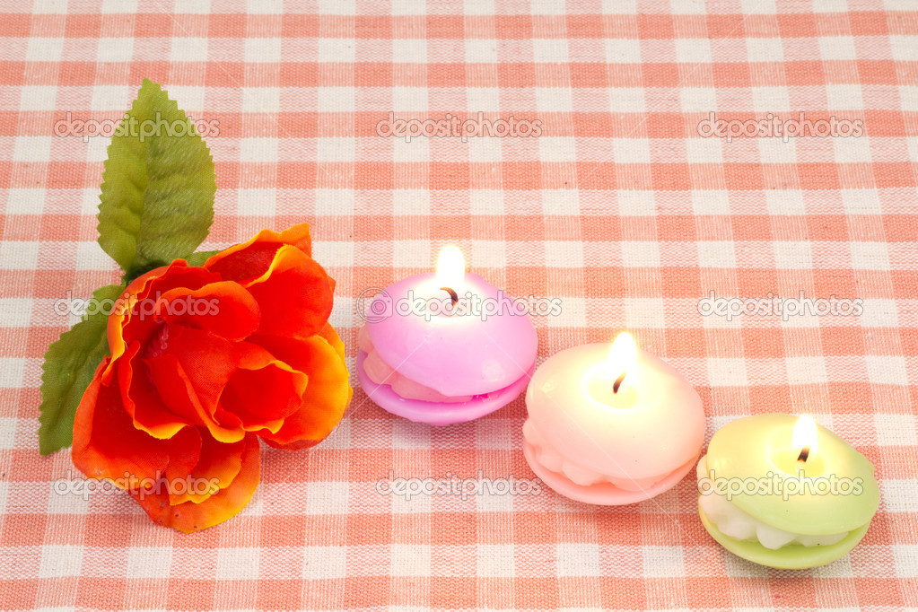This is a picture of artificial rose and candles. — Stock Photo #19208615