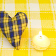 Heart and a candle - Stock Photo