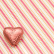 Pink heart-shaped chocolate - Stock Photo