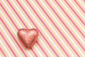Pink heart-shaped chocolate — Stock Photo