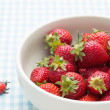 Strawberries in a bowl and ladybird — Stock Photo #23571809
