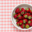 Strawberries in a bowl and ladybird — Stock Photo #24036545