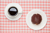 Chocolate cream puff and coffee — Stock Photo