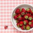 Strawberries in a bowl and ladybird — Stock Photo