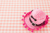 Cute hat on the tablecloth — Stock Photo