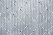 Chain-link fence of blue — Stock Photo