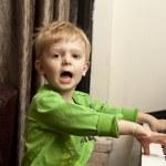Boy playing on piano. — Stock Photo #18364775
