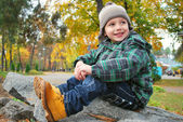 Beautiful boy in the autumn park — Stock Photo