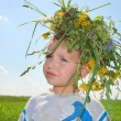 Boy with wreath - Stok fotoğraf