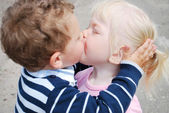 Boy and girl kissing. — Stock Photo