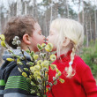 Spring. The boy kisses the girl.                                                                                                                     — Stock Photo