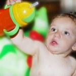Little boy holding bottle — Stock Photo #21581831