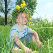 Foto de Stock  : Boy wearing crown of flowers