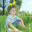Boy wearing a crown of flowers - Foto Stock