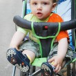 Boy sitting in stroller — Stock Photo #22001289
