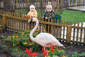 Boy girl and flamingos — Stock Photo