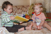 The boy reads the book girl — Stock Photo