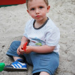 Little boyl playing in the sandbox — Stock Photo