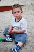 Little boyl playing in the sandbox — Stock Photo