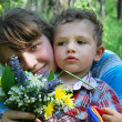 The girl and boy  with a bouquet of wild flowers — Stock Photo