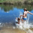 the boy and girl  is bathed dives, jumps into the river. — Stock Photo