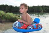 A little boy swimming — Stock Photo