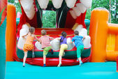 In the amusement park, inflatable slide for kids climbs. — Stock Photo