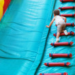 Little boy playing on an inflatable playground — Stock Photo