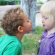 So kiss me! The little girl wants to kiss a boy. — Stock Photo #34804407