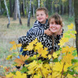 Mother and son playing in the autumn forest, — Stock Photo