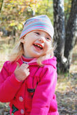 Beautiful little girl laughs heartily — Stock Photo
