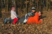 Family dabbles in the autumn forest. — Stock Photo