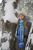 Winter, snow-covered forest,standing the beautiful girl . — Stock Photo