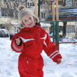 Winter boy playing in snow near playground. — Stock Photo #38590985