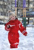 Winter boy playing in the snow near the playground. — Stock Photo