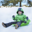Boy riding hills on sleds — Stock Photo #38631251