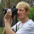 Stockfoto: Paparazzi. Unshaven mwith camera