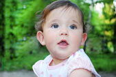 Little girl outdoors in summer. close up. — Stock Photo