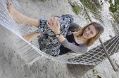 Girl lying in a hammock. — Stock Photo