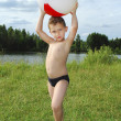 Stock Photo: Lake little boy playing with inflatable ball