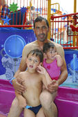 Family at the water park. — Stock Photo