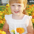 summer girl stands in the colors of marigolds — Stock Photo