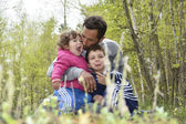 Family dabbles in the forest. — Stock Photo