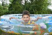 Boy sitting in the pool. — Foto de Stock